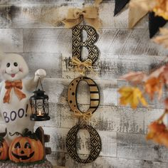 Add texture to your decor with our Pretty Patterns Hanging Boo Sign. The wooden letters and burlap detailing give off a chic rustic vibe. Hang yours in your entryway to add dimension and personality.