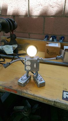 Husband made this for my friends son.  Robot Lamp