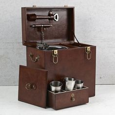 This leather drinks box includes an ice bucket; leather handled ice tongs, corkscrew and bottle opener; and features enough space for two bottles & a drawer with 9 stainless steel beakers Buy Gifts Online, Online Gift Shop, Mini Bar At Home, Ice Tongs, Bar Cart Styling, Conkers, Stainless Steel Cups, Tool Steel, Leather Working