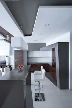 Interior: Elegant White Grey Kitchen With Laminate Countertops And Laminate Wooden Cabinets Also Grey Kitchen Bars And Modern White Stools Design Ideas: Dramatic All-White Apartment Renovation in Moscow by Vladimir Malashonok White Apartment, Minimalist Apartment, Minimalist Kitchen, Modern Minimalist, Minimalist Design, Modern Interior, Home Interior Design, Interior Architecture, Interior Decorating