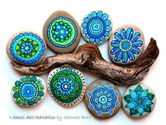 Love these blue, green ‪#‎paintedstone‬ flowers   Can't wait to paint other flowers with different color combinations  #isassidelladriatico #paintedstones