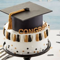 They may throw the tassel, but you'll be throwing the party with this Graduation Tassel Cake. Decorated with little mini tassels and a gum paste graduation cap, this two-layer cake is great for parties and post-commencement get-togethers. Graduation Tassel, Graduation Cake, Graduation Ideas, Two Layer Cakes, First Communion Cakes, Cap Cake, Paris Cakes, Horse Cake, Harry Potter Cake