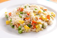 This vegetarian risotto recipe incorporates edamame, mushrooms and Parmesan cheese into a delicious dish. Your kids will definitely ask for seconds. Risotto, Edamame, Tasty Dishes, Yummy Food, Delicious Recipes, Parmesan, Stuffed Mushrooms, Cheese, Kids