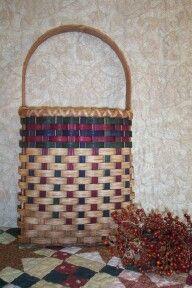 Flat wall basket woven on an oak handle by Jean Johnson
