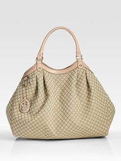 Gucci Sukey...what i am carrying now...LOVE!!! Mine has the black piping/trim.