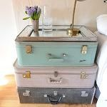 bedrooms - nightstand pastel stacked vintage suitcases