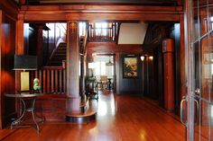 The wood was hand cut, including the molding details. Bookmatched panels on the walls and doors, and floating beams above. 1909 Birmingham, Alabama