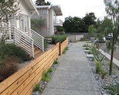 Awesome Curbside Landscaping Ideas for Your Home : Marvelous Modern Curbside Landscaping Ideas Concrete Walk Street Wooden Fence White Woode...