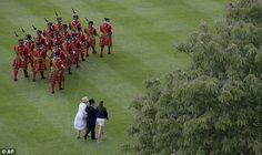 Yeomen of the Guard march across the lawn during the Buckingham Palace Garden Party, 28 May 2015.