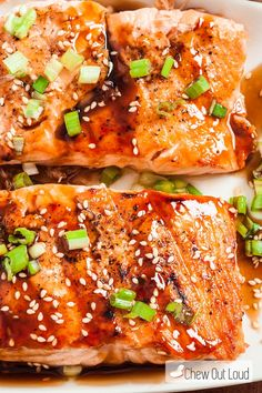 This Grilled Teriyaki Salmon is out of this world delicious! It's tender, flaky, and packed with awesome flavor. This is the BEST teriyaki sauce you'll ever brush onto any grilled meat!!