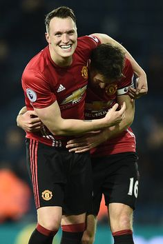 Manchester United's English defender Phil Jones and Manchester United's English midfielder Michael Carrick celebrate on the pitch after the English. Michael Carrick, Phil Jones, West Bromwich, Man United, Manchester United, Stock Pictures, Royalty Free Photos, The Unit, Football