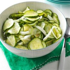 Sweet-Tart Cucumber Salad Recipe -A dear friend showed me how to use up cucumbers in a tangy salad. The longer it chills, the deeper the flavor. Look for lemon or pickling cucumbers. —Dian Jorgensen, Santa Rosa, California