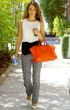 Jessica Alba wearing Rupert Sanderson Elba Pumps, Sandro Paris Printed Pants, Narciso Rodriguez Claire Zip Tote in Cayenne Orange Suede and Jacquie Aiche Starburst Ear Jacket.