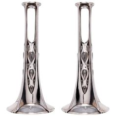 Pair of Candlesticks / Bud Vases by WMF Attributed to Albin Müller | From a unique collection of antique and modern candle holders at https://www.1stdibs.com/furniture/decorative-objects/candle-holders/