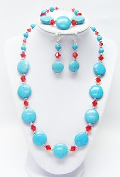 Turquoise Howlite Flat Round Discs w/Red Crystal Bicone Bead Necklace/Bracelet/ Earrings Set by SabrinaDesignJewelry on Etsy https://www.etsy.com/listing/240314641/turquoise-howlite-flat-round-discs-wred