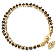 This grown-up friendship bracelet features hand-cut black spinel gemstones with a sapphire pavé Evil Eye charm set in 18 carat yellow gold plated sterling silver. Inspired by treasured talismans, this bracelet symbolises wisdom and is finished with our Astley Clarke signature star-set sapphire.