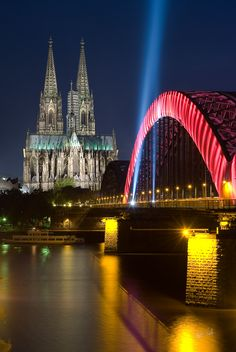 Cologne ('Köln'), Germany,  Cathedral and the Hohenzollern Bridge across the River Rhine.  by Christian Bothner