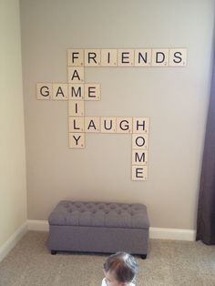 Love this!! Scrabble wall feature for game room. MomAboutCharlotte.com