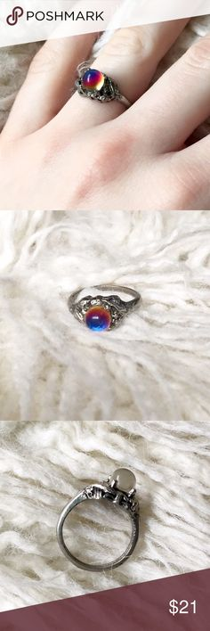 Vintage Sterling a Silver Glass Crystal Ball Ring Vintage • Size 5 - 5 1/4 • Has a crystal ball that shines blue, purple, red, and yellow in the sunlight • Crystal ball is totally clear from the side • Thin band • Comfortable to wear • Make an offer! Vintage Jewelry Rings