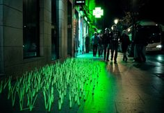 """Madrid: blades of neon """"grass"""" gather luminosity from city night-lit skies in artistic protest to light pollution. http://www.facebook.com/Luzinterruptus"""