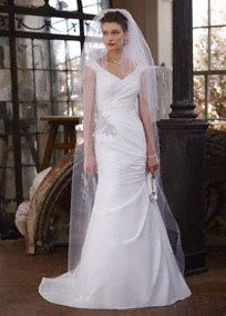 This romantic off the shoulder wedding dress exudes grace and refinement for a truly luxurious feel!  Taffeta cap sleeve gown features side draping detailcreating a stunning silhouette.  Gorgeous beading at waist adds a touch of opulence.  Sweep train.