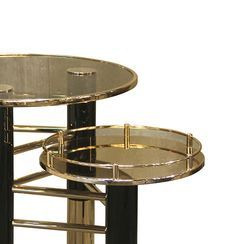 Ike side Table features a brown glass top with a gold trim, three neat Gold Plated and Glossy Black legs are firmly kept in place by a set of brass tubes in a beautiful composition.