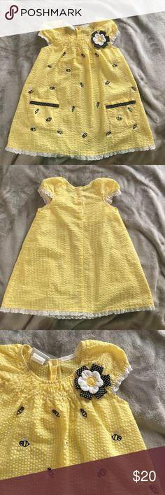 ☀️BOGO FREE all kids' items!☀️ This dress is so sweet! 😍 yellow and white seersucker with bees embroidered on the front and three button closure on the back. The size is 2T but once it got a little short for my daughter we just added white leggings and she got another year out of it! Lace detailing around arms and hem complete the look.🌟 Make a bundle and send me an offer with the lower priced item(s) subtracted Dresses