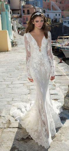 Featured Dress: Julie Vino; Long-sleeve plunging neckline wedding dress.