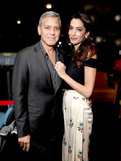 Amal Welcomes Fall! Amal Clooney Rocks Floral Pants and a Black Crop Top at CharityEvent