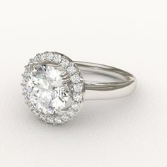Cathedral and Halo Round Cut Diamond Engagement Ring with Double Prongs