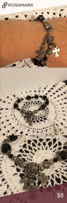 Cross stretch bracelet Black and silver stretch bracelet with 3 cross charms hanging. Jewelry Bracelets