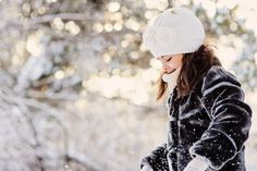 happy child girl on the walk in snowy winter forest, outdoor seasonal activity on winter holidays