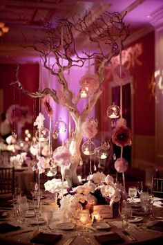 Large branch with hanging glass ball candle holders and flowers on ribbon. This bride used this set up for a (head?) table centerpiece and also for the place card table. Sepi and Amid from California