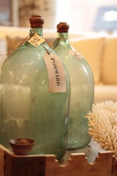 vintage glass jugs.  I will never forget the magazine picture with an all white living room, with one huge aqua glass jug like this.  Amazing.