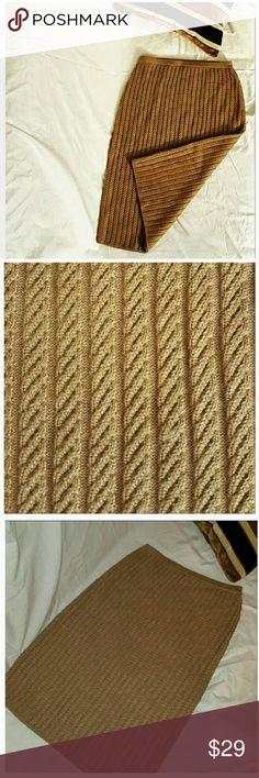 "Jones New York Knit Midi Skirt Beautiful Jones New York Knit Midi Skirt Perfect for the cooler months Brown Color Length is 25.5"" Waist is 26"" Hip is 36""  Size Small Elastic Waist Skirt is stretchy  50% Viscose 30% Rayon 20% Polyester Very good condition Jones New York Skirts Midi"