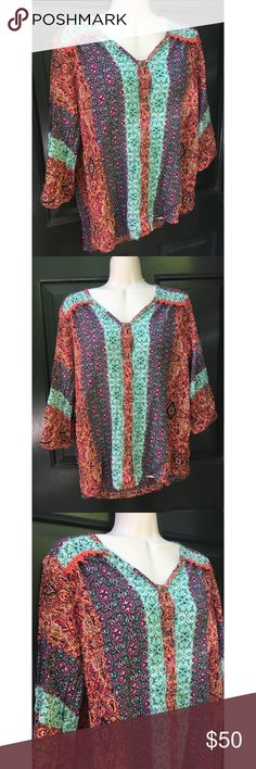 ✨ Gorgeous Gypsy 05 Bohemian Colorful Top - Gorgeous Gypsy 05 Bohemian Colorful Top - Super vibrant colorful boho top from a LA brand Gypsy 05 - Main colors: orange, turquoise, red/pink, white  - Buttons up the front, can be worn open or closed  - Lace detailing on the back  - In great condition, barely worn  - A bit high low, but mostly equal in length  - Brand: Gypsy 05 - Size: M (would fit oversized size S also)  *20% off 2+ * Make me an offer!! Gypsy 05 Tops Blouses