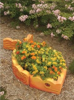 fish planter. It looks like this is made by painting those cheap concrete edgers!