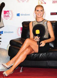 Stunning Heidi Klum crossed legs in a tiny mini-dress and heels promoting MTV EMAs #legs #heels