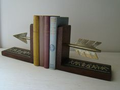 Vintage arrow bookends would make a great addition to any chapter house! Available from joellecutro on Etsy.com.