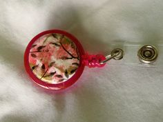 Clip on Badge Holder in Hot Pink.  It's a holder for magnetic discs, pick the base then get discs to coordinate!