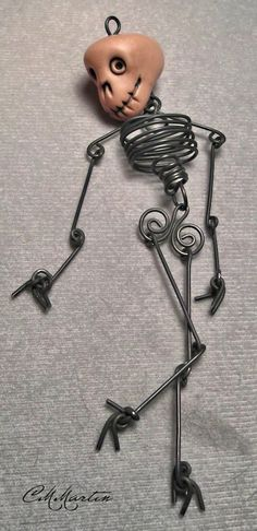 Wire Skeleton with GlowintheDark Skull by cmmartinwa on Etsy
