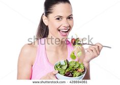 Portrait of attractive smiling woman eating salad