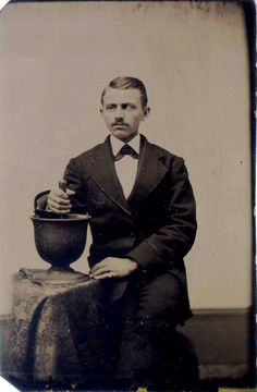 ca. 1860-90, [tintype portrait of a pharmacist with his large mortar and pestle] via Jeffrey Kraus Antique Photographica, Tintype Collection
