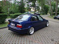 BMW e36 sedan on cult classic OZ AC Schniter type 1 wheels