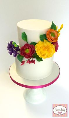 Colorful flowers for a christening cake by Sweet Lily Atelier