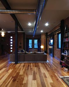 Rich wood floors, exposed brick, and exposed duct work. Warm, natural, hip.