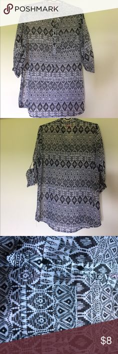 Tribal Print Chiffon Blouse NWOT It's like a chiffon lightweight material very see through. 100% polyester. Great for the summer weather. Tops Blouses