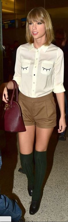 Who made Taylor Swift's red handbag, white button down shirt, and tan pleated shorts at LAX airport on October 21, 2014