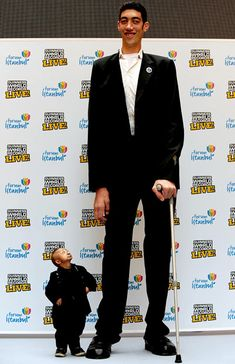 The world's tallest man, Sultan Kosen, standing at 8 ft 1 in (246.5 cm),  poses with shortest man in the world, He Pingping, standing at 2 ft 5.37 in (74.61 cm)