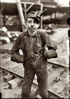 """August 1908. Tipple boy at the Turkey Knob coal mine in Macdonald, West Virginia. Says the LOC: """"Patron identifies this as her grandfather, Otha Porter Martin, born July 3, 1897."""" Photograph by Lewis Wickes Hine. """"Tipple refers to the superstructure above ground that housed the draw works (hoist engine, cable drum, gear head etc) and the conveyor that took the ore away when the ore cart was tipped when it reached the surface."""""""